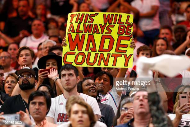 Miami Heat fan holds a sign against the Charlotte Hornets during the second half at American Airlines Arena on October 20 2018 in Miami Florida NOTE...