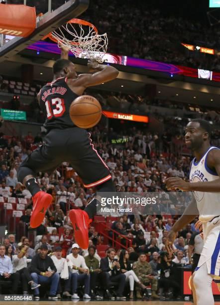 Miami Heat forward Bam Adebayo dunks against Golden State Warriors forward Draymond Green during the first quarter on Sunday Dec 3 2017 at...