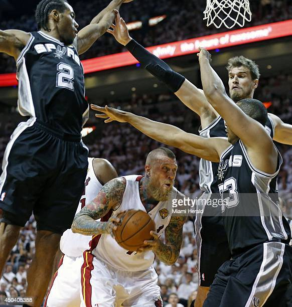 Miami Heat forward Chris Anderson looks for an opening through San Antonio Spurs defenders in the first quarter during Game 3 of the NBA Finals at...