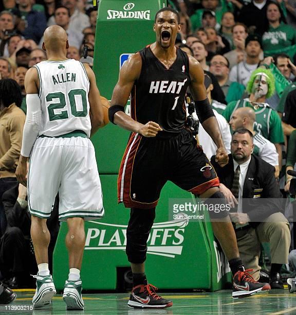 Miami Heat forward Chris Bosh celebrates scoring off an offensive rebound in overtime against the Boston Celtics during Game 4 of their NBA Eastern...