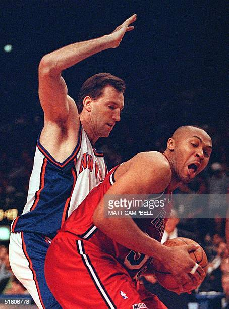 Miami Heat forward Clarence Weatherspoon pulls a rebound away from New York Knicks center Chris Dudley in the first quarter 05 May 1999 at Madison...