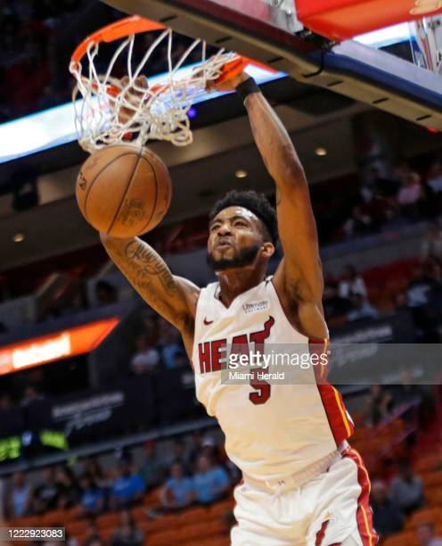 Miami Heat forward Derrick Jones Jr dunks against the Charlotte Hornets on March 11 at AmericanAirlines Arena in Miami