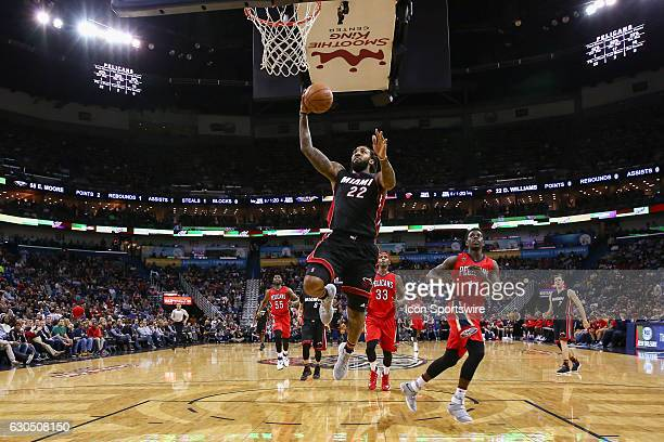 Miami Heat forward Derrick Williams drives to the basket against New Orleans Pelicans guard Jrue Holiday during the game between the against the New...