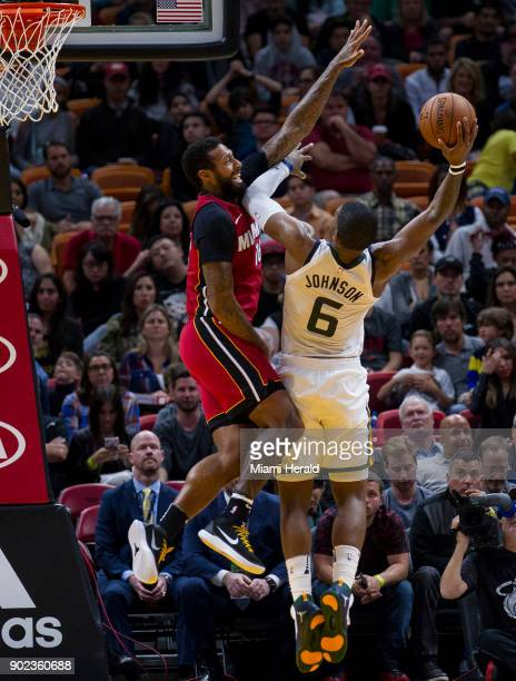 Miami Heat forward James Johnson guards against Utah Jazz's Joe Johnson in the fourth quarter on Sunday Jan 7 2018 at the AmericanAirlines Arena in...
