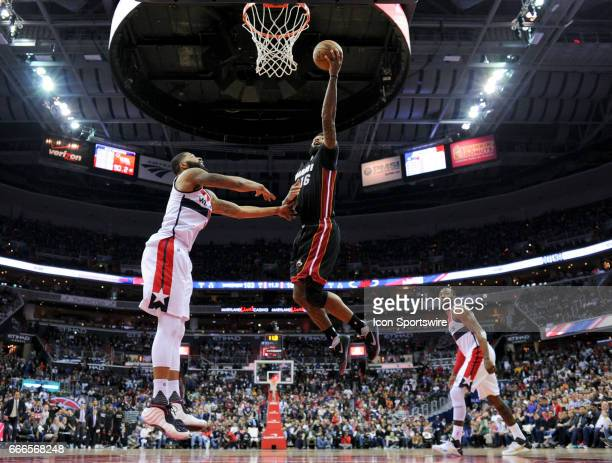 Miami Heat forward James Johnson scores the game winning basket late in the second half against Washington Wizards forward Markieff Morris on April 8...