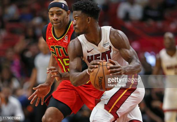 Miami Heat forward Jimmy Butler drives against Atlanta Hawks guard Vince Carter in the fourth quarter on Tuesday, Oct. 29, 2019 at the...