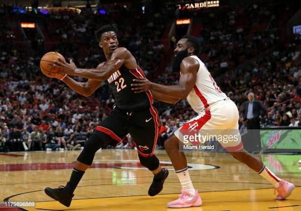 Miami Heat forward Jimmy Butler drives against Houston Rockets guard James Harden in the first quarter on Sunday, Nov. 3, 2019 at the...