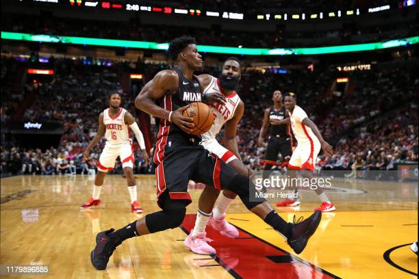 Miami Heat forward Jimmy Butler drives against Houston Rockets guard James Harden in the second quarter on Sunday, Nov. 3, 2019 at the...
