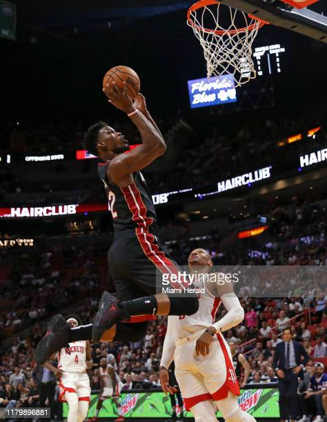 Miami Heat forward Jimmy Butler goes to the basket against Houston Rockets guard Russell Westbrook in the first quarter on Sunday, Nov. 3, 2019 at...