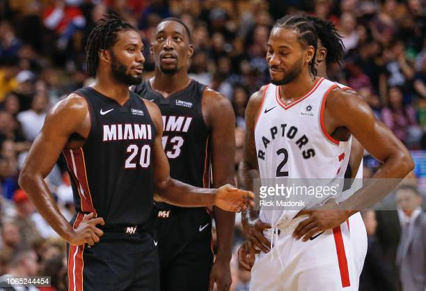 Miami Heat forward Justise Winslow seems to be explaining to Toronto Raptors forward Kawhi Leonard about the foul called on him Toronto Raptors vs...
