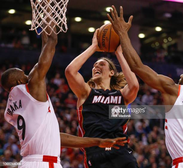 Miami Heat forward Kelly Olynyk gets past Toronto Raptors forward Kawhi Leonard as Toronto Raptors forward Serge Ibaka waits but to no avail as Olynk...