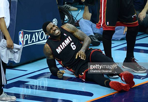 Miami Heat forward LeBron James grimaces in pain after going down against the Charlotte Bobcats in the third quarter of Game 4 of the NBA Eastern...