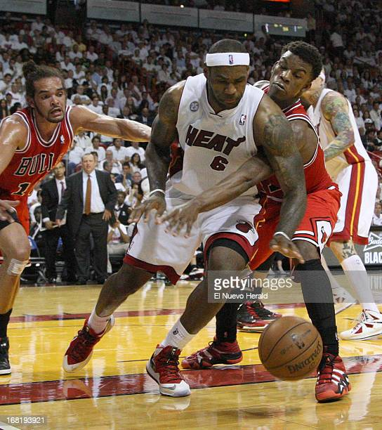 Miami Heat foward LeBron James fights for the ball with Chicago Bulls guard Jimmy Butler in the third quarter of the NBA Eastern Conference playoffs...