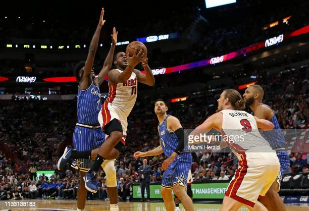 Miami Heat guard Dion Waiters goes to the basket against Orlando Magic forward Jonathan Isaac in the first quarter of an NBA basketball game at the...