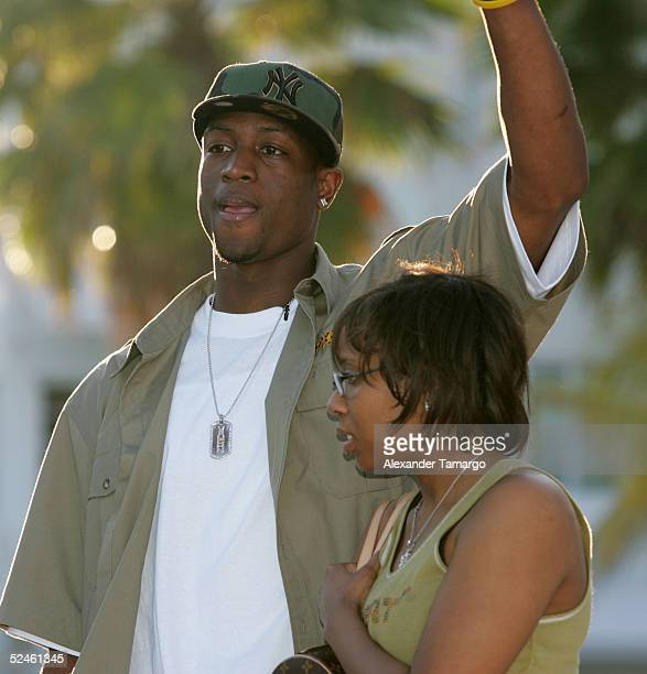Miami Heat guard Dwyane Wade and his wife attend the 8th Annual Miami Heat Family Festival on March 20 2005 in Miami Beach Florida