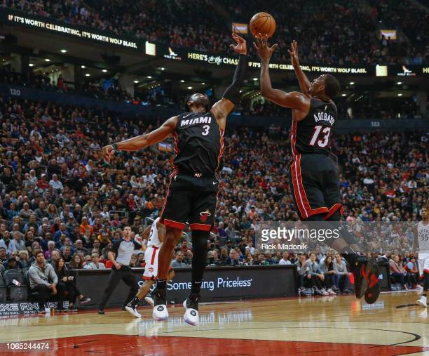 Miami Heat guard Dwyane Wade and Miami Heat center Bam Adebayo combine for a defensive rebound Toronto Raptors vs New Orleans Pelicans in 1st half...