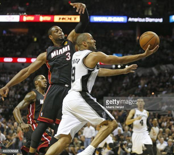 Miami Heat guard Dwyane Wade defends against the San Antonio Spurs' Tony Parker during the second quarter in Game 2 of the NBA Finals at the ATT...
