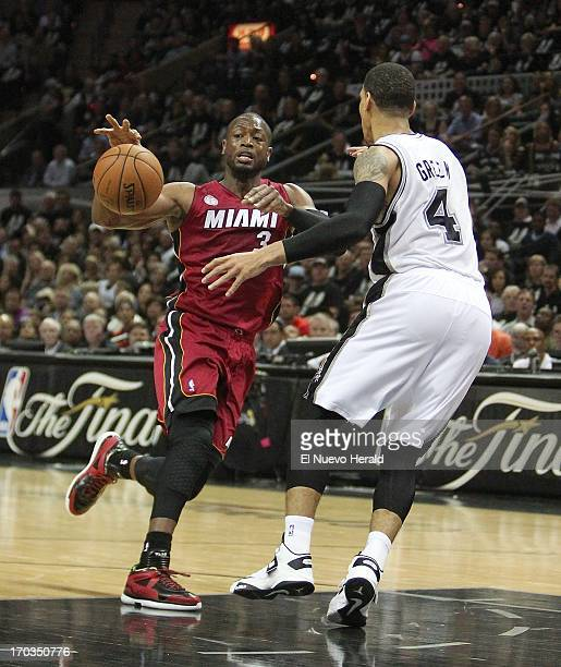 Miami Heat guard Dwyane Wade drives against San Antonio Spurs guard Danny Green during the first quarter in Game 3 of the NBA Finals Tuesday June 11...