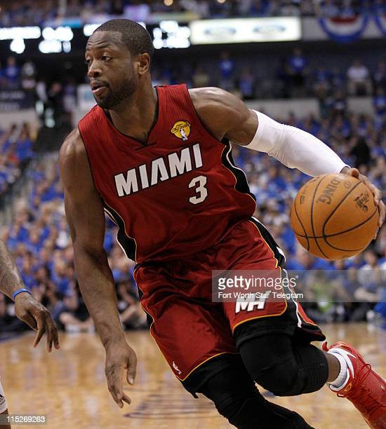 Miami Heat guard Dwyane Wade drives the ball against the Dallas Mavericks during Game 3 of the NBA Finals at the American Airlines Center in Dallas,...