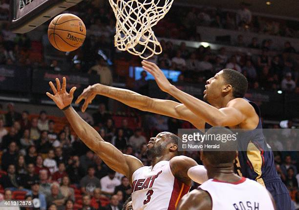 Miami Heat guard Dwyane Wade goes to the basket against New Orleans Pelicans forward Anthony Davis during the first quarter at the AmericanAirlines...