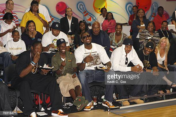 Miami Heat guard Dwyane Wade, guest, Cleveland Cavaliers forward Lebron James, Denver Nuggets forward Carmelo Anthony and DJ Clue enjoy the finals...