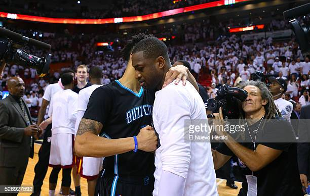 Miami Heat guard Dwyane Wade hugs Charlotte Hornets guard Courtney Lee after Game 7 of the first round of the 2016 NBA Eastern Conference Playoffs on...