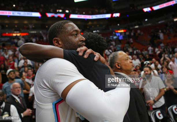 Miami Heat guard Dwyane Wade hugs his son Zaire after a 9185 win against the Milwaukee Bucks at the AmericanAirlines Arena in Miami on Friday Feb 9...