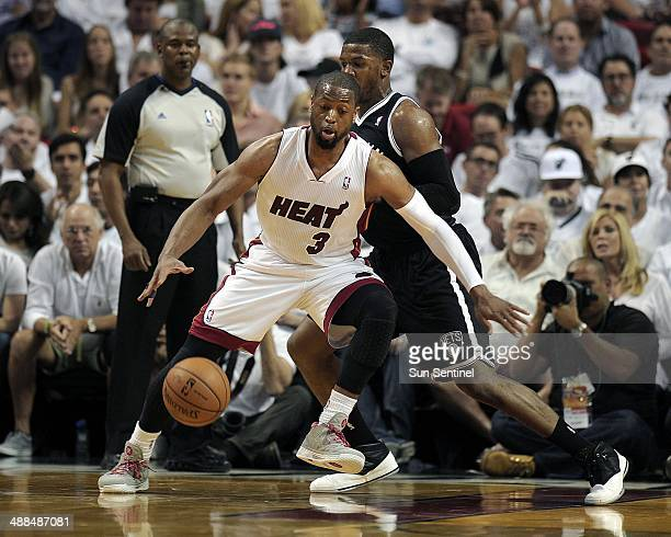 Miami Heat guard Dwyane Wade makes a move on Brooklyn Nets Joe Johnson during the second quarter in Game 1 of the Eastern Conference semifinals at...