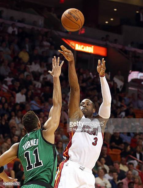 Miami Heat guard Dwyane Wade shoots over Boston Celtics' Evan Turner during the second quarter on Monday Nov 30 at AmericanAirlines Arena in Miami