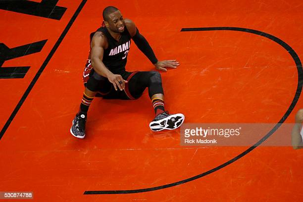 Miami Heat guard Dwyane Wade sits in the paint after not getting a call Toronto Raptors V Miami Heat during 2nd half action of Game 5 of 2nd round...