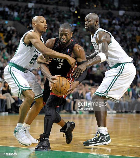 Miami Heat guard Dwyane Wade splits the defense of the Boston Celtics Ray Allen and Kevin Garnett during the first half in Game 4 of the NBA Eastern...