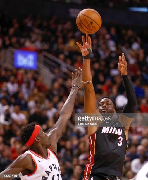 Miami Heat guard Dwyane Wade throws up a three ball Toronto Raptors vs New Orleans Pelicans in 2nd half action of NBA regular season play at Air...