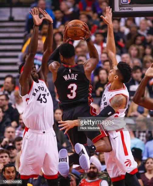 Miami Heat guard Dwyane Wade tries to split the defence of Toronto Raptors forward Pascal Siakam and Toronto Raptors guard Danny Green Toronto...