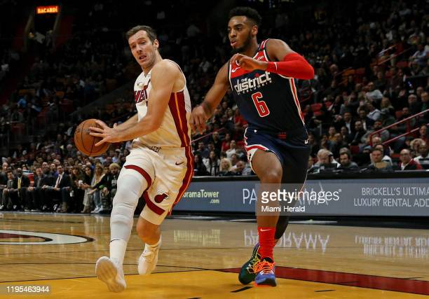 Miami Heat guard Goran Dragic drives against Washington Wizards guard Troy Brown Jr the second quarter at the AmericanAirlines Arena in Miami on...
