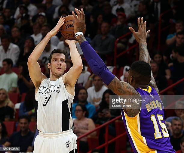 Miami Heat guard Goran Dragic shoots against Lakers' Thomas Robinson in the first quarter of the Miami Heat vs Los Angeles Lakers Thursday Dec 22...