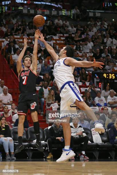 Miami Heat guard Goran Dragic shoots over Golden State Warriors center Zaza Pachulia during the first quarter on Sunday Dec 3 2017 at...