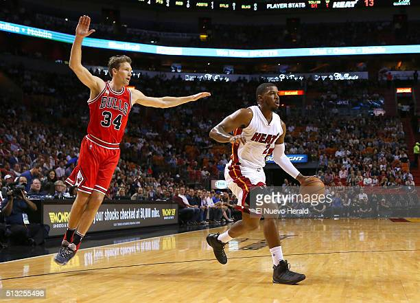 Miami Heat guard Joe Johnson drives against Chicago Bulls guard Mike Dunleavy during the first quarter on Tuesday March 1 at the AmericanAirlines...