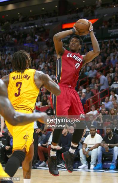 Miami Heat guard Josh Richardson shoots over Cleveland Cavaliers forward Derrick Williams during the first quarter of an NBA basketball game at...