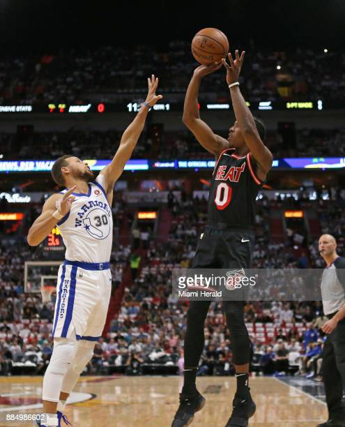 Miami Heat guard Josh Richardson shoots over Golden State Warriors guard Stephen Curry during the first quarter on Sunday Dec 3 2017 at...