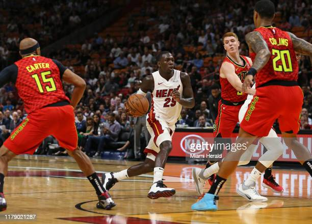 Miami Heat guard Kendrick Nunn drives against Atlanta Hawks guard Vince Carter Kevin Huerter and John Collins in the first quarter on Tuesday Oct 29...