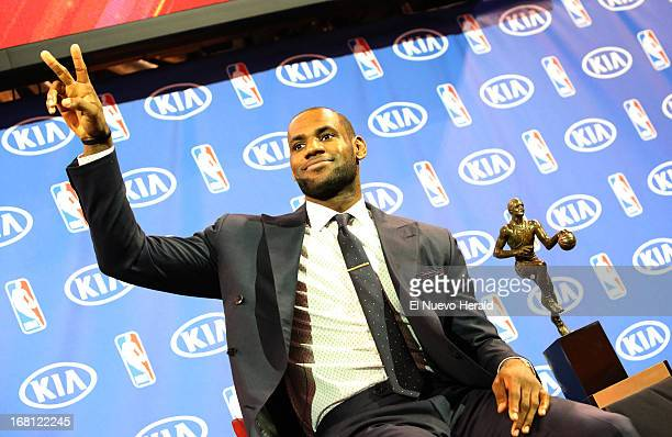 Miami Heat guard LeBron James sits by the Maurice Podoloff Trophy during a ceremony at the American Airlines Arena in Miami, Florida, Sunday, May 5,...