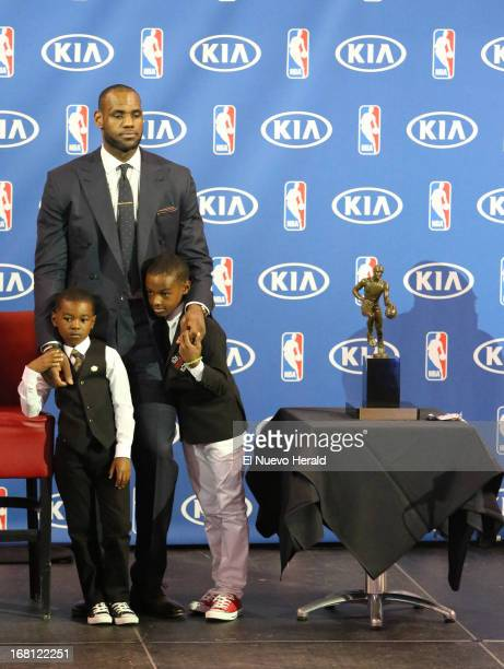 MIami Heat guard LeBron James stands along with his kids Bryce James left and LeBron James Jr by the Maurice Podoloff Trophy during a ceremony on...