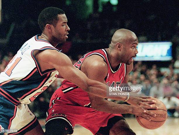 Miami Heat guard Tim Hardaway tries to keep the ball away from New York Knicks guard Charlie Ward in the first quarter of the third game of their...