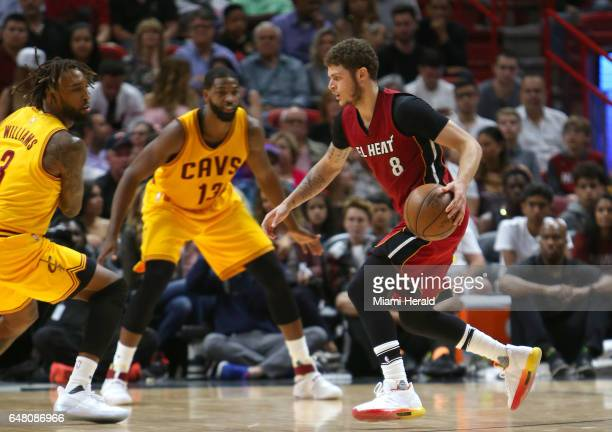 Miami Heat guard Tyler Johnson drives against Cleveland Cavaliers forward Derrick Williams during the third quarter of an NBA basketball game at...