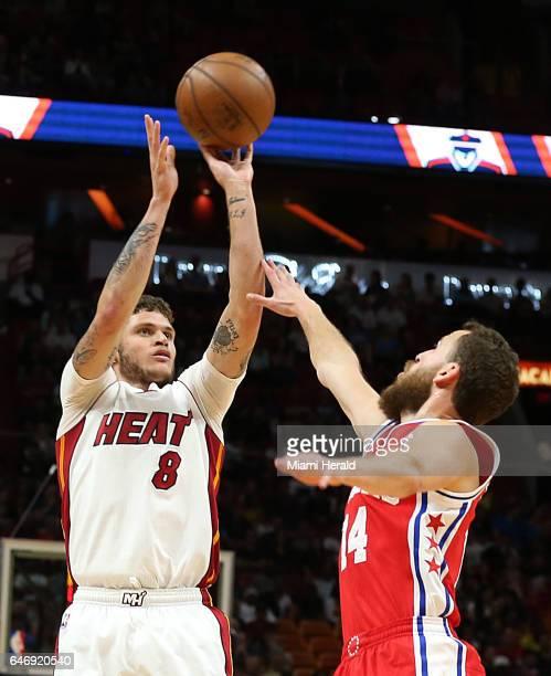 Miami Heat guard Tyler Johnson shoots to the basket against Philadelphia's Sergio Rodriguez in the second quarter of the Miami Heat vs Philadelphia...