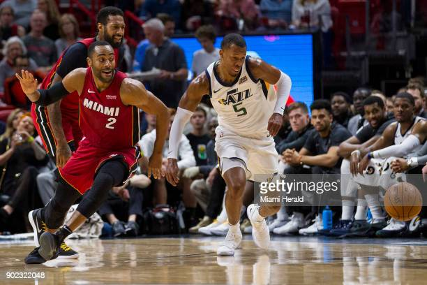 Miami Heat guard Wayne Ellington fights for possession of the ball against the Utah Jazz's Rodney Hood in the second quarter on Sunday Jan 7 2018 at...
