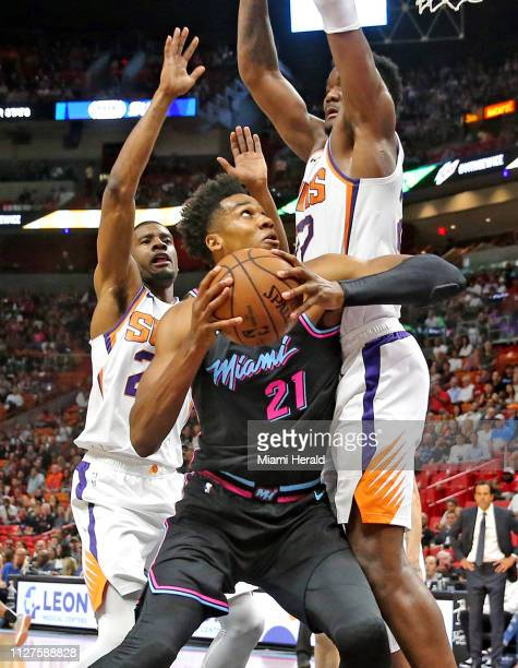 Miami Heat Hassan Whiteside pushes to the basket as Phoenix Suns Josh Jackson and Deandre Ayton guard in the first quarter at the AmericanAirlines...
