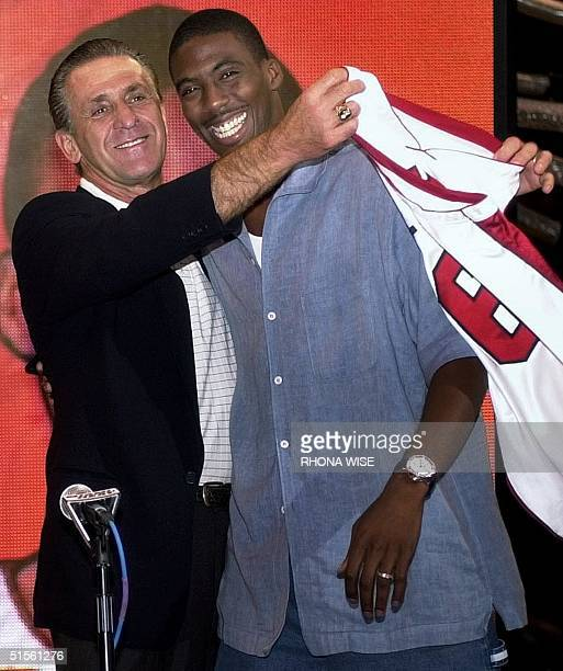 Miami Heat head coach Pat Riley embraces newly acquired All Star guard Eddie Jones as he presents him with his new jersey in front of the media at a...