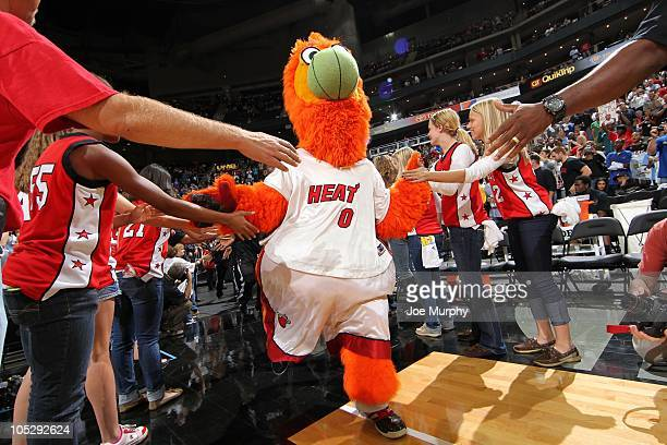 Miami Heat mascot Burnie runs on the court before a preseason game against the Oklahoma City Thunder on October 8 2010 at the Sprint Center in Kansas...