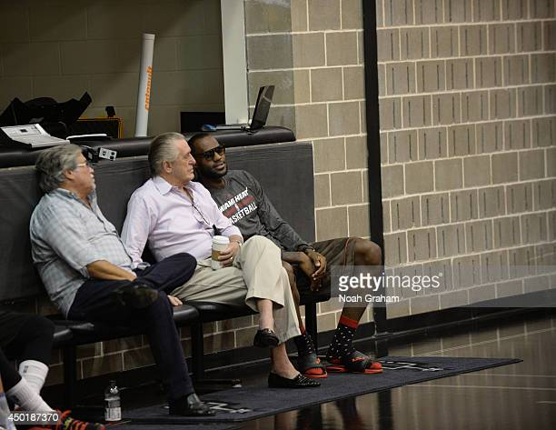 Miami Heat owner Micky Arison President Pat Riley and LeBron James observe practice during media availability as part of the 2014 NBA Finals on June...